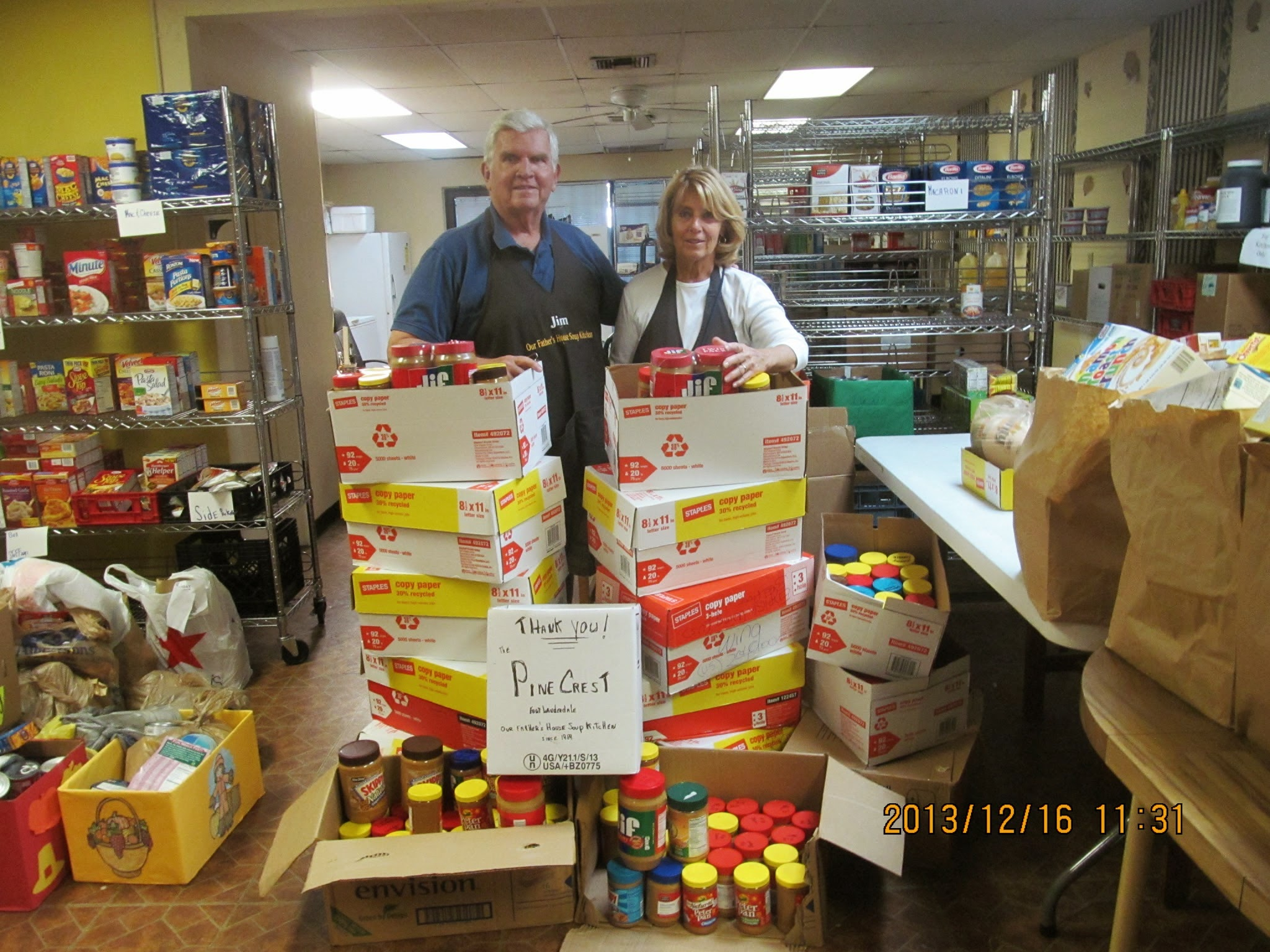 "Soup kitchen volunteers thanking ""Pine Crest"" for the donation of goods."