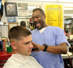 A man gives out haircuts to help the poor.