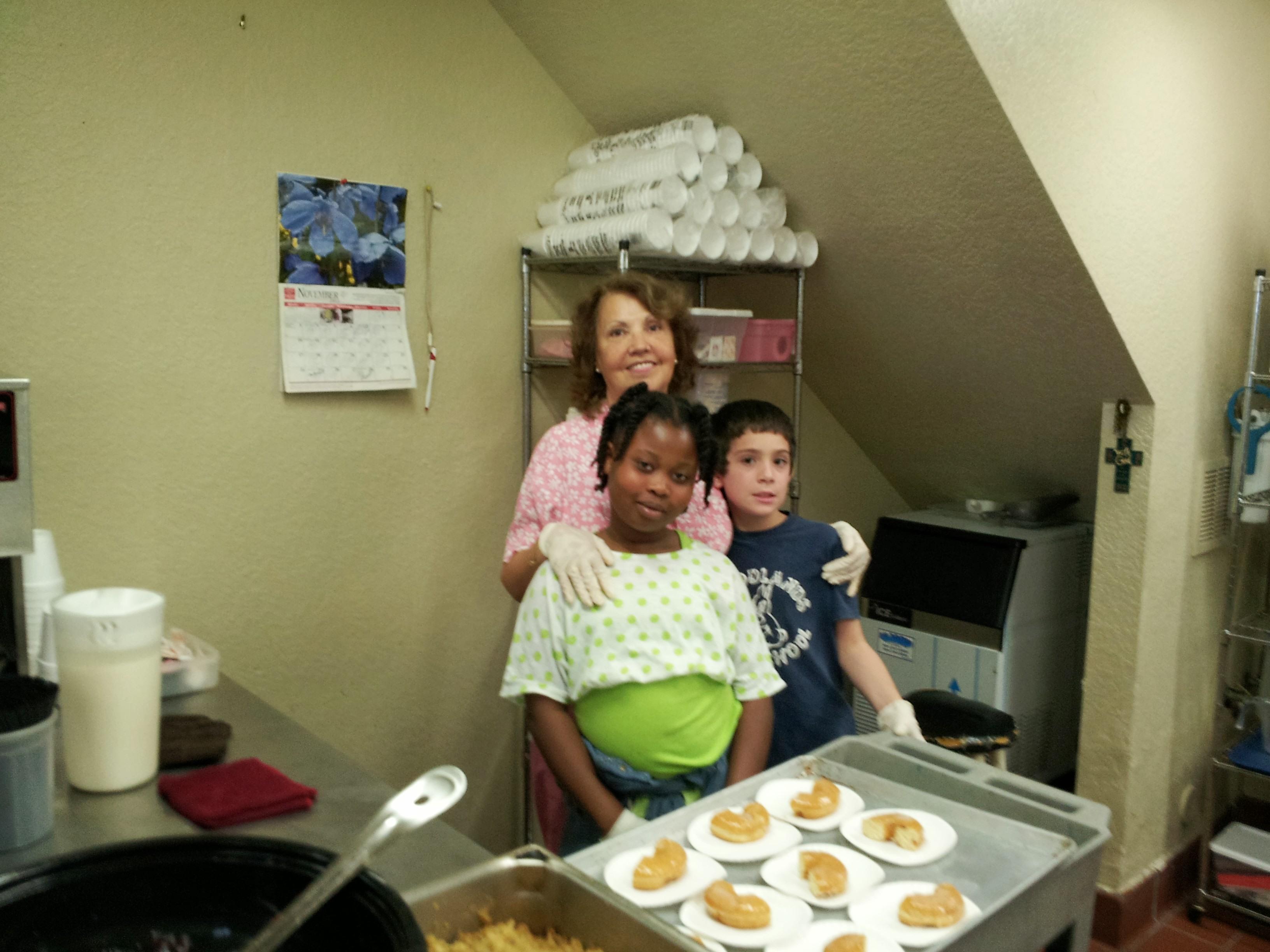 Soup kitchen volunteers preparing food for homeless people.