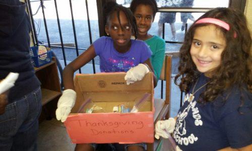 Children volunteer in a non profit organization prepares donations for the needy.