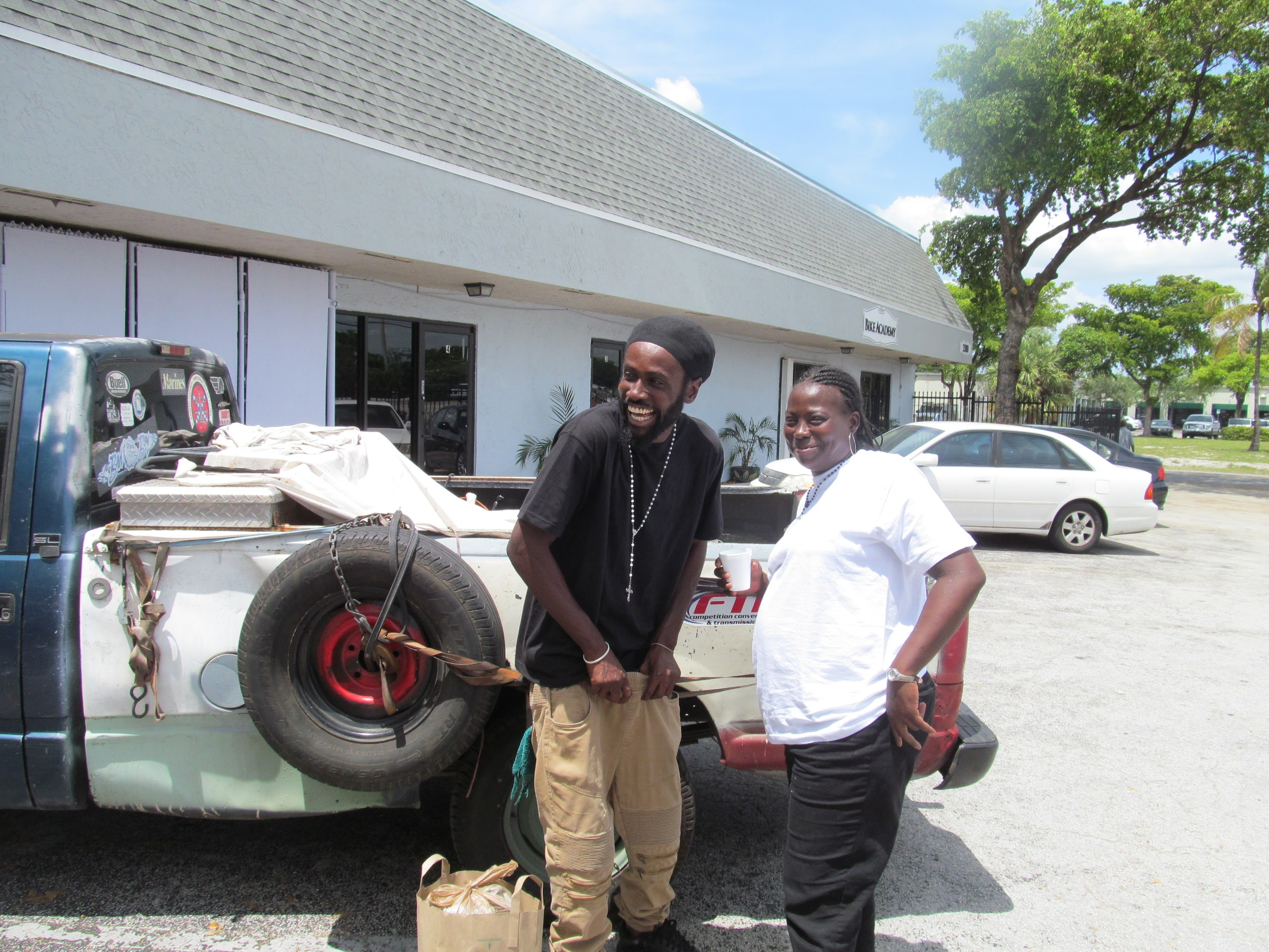 Homeless people are happy to take a picture outside Our Father's House Soup Kitchen.