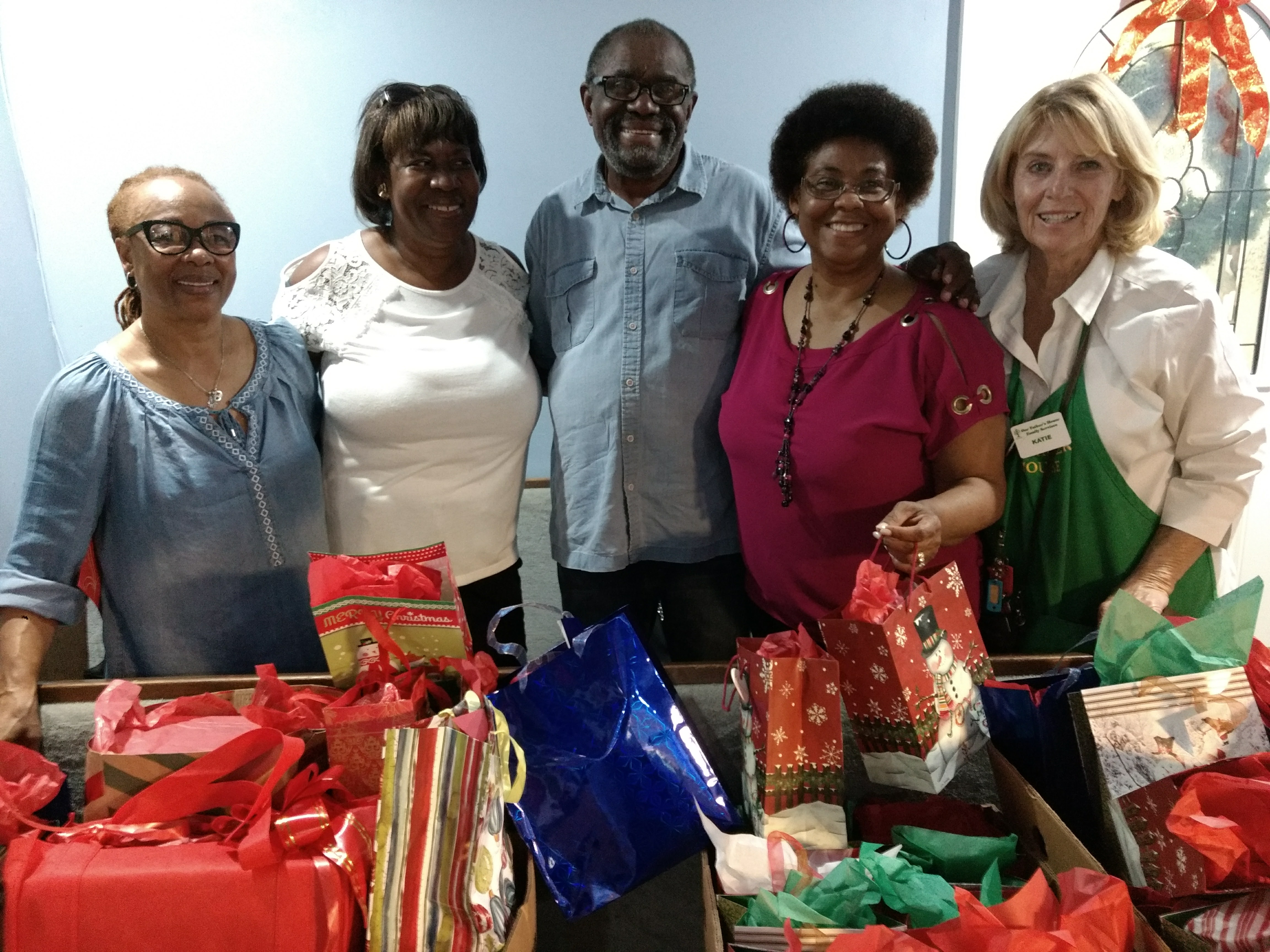Homeless charity volunteers giving Christmas gifts to homeless people.