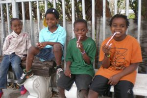Children enjoy eating their candy from non profit organization.