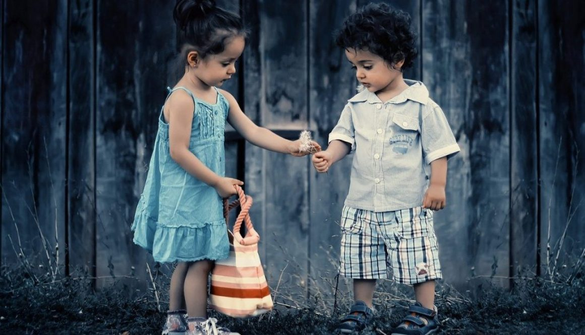 One child giving flowers to another - an example of teaching moral values to children.