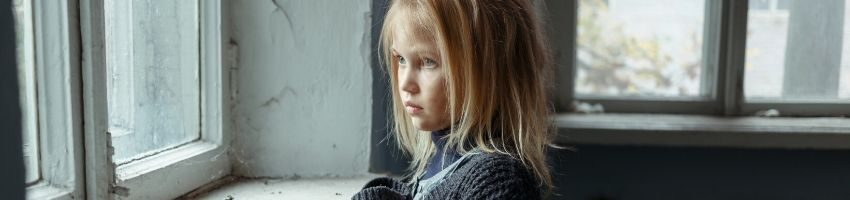 A homeless child who is also a victim of domestic abuse.