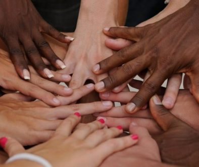 Diverse human hands showing unity and humanity for love