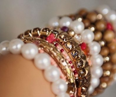 A picutre of bracelets of a woman that she received in a good cause event