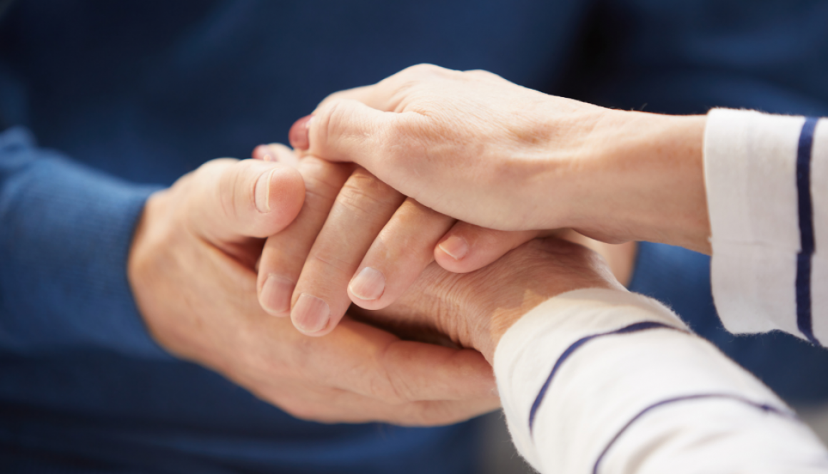 Man holding someone's hand and showing empathy