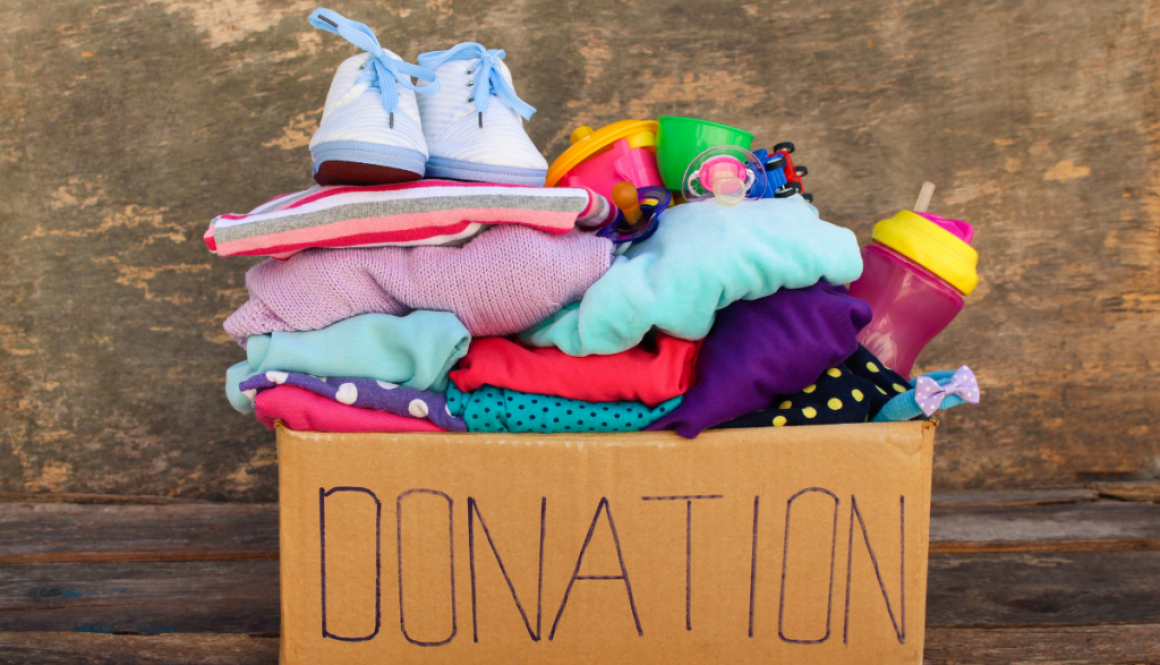 A picture of baby clothes placed inside the donation box