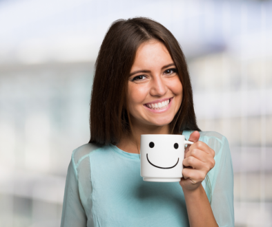 A woman smiling after reading stay positive quotes.