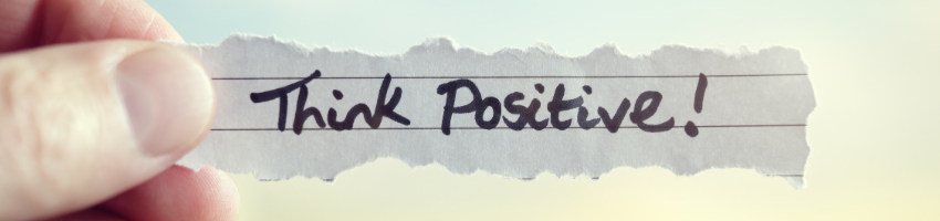 A piece of paper containing a stay positive message.