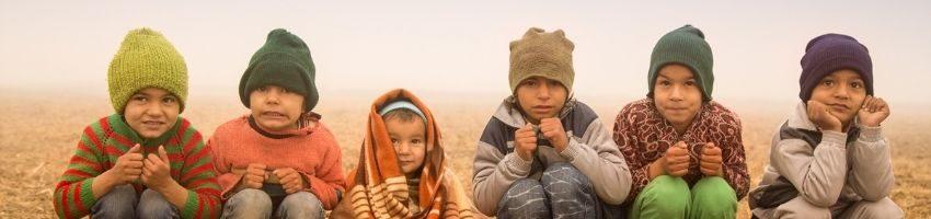 Underprivileged Children sitting around the cold place
