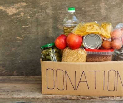Donation foods for homeless placed under the wooden table
