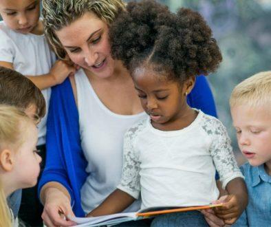 Woman reading bible stories to kids